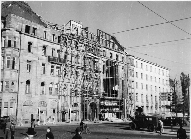 The Grand Hotel housed prosecution staff/guests and was the social center for U.S. War Crimes personnel in Nuremberg. A bomb had dropped through to the basement. Many IMT staff were billeted here even while under construction - and spoke of missing windows, walls and bath mats containing little swastika patterns –harkening back to the days of Hitler's grand rallies and parades.