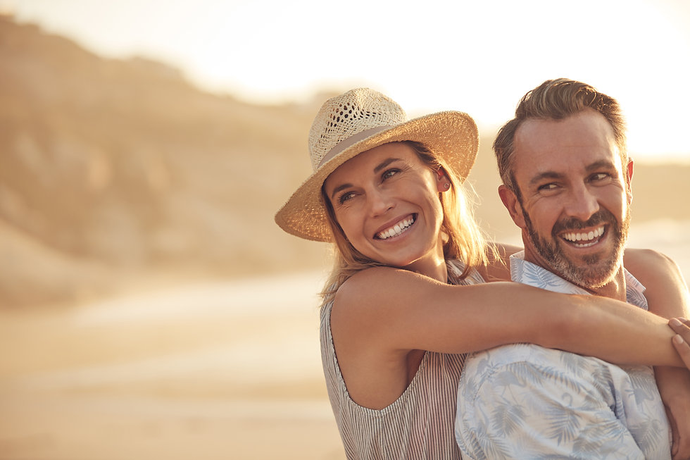 Mature Couple Hugging on Beach.jpg
