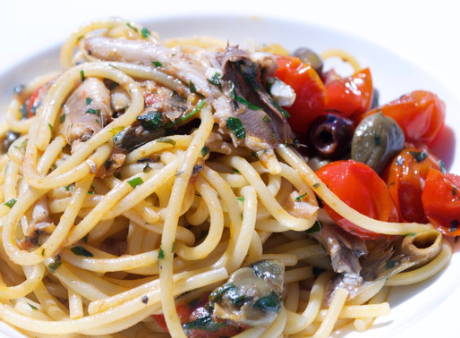 Sardines' Puttanesca spaghetti and special Cetara's anchovy dressing