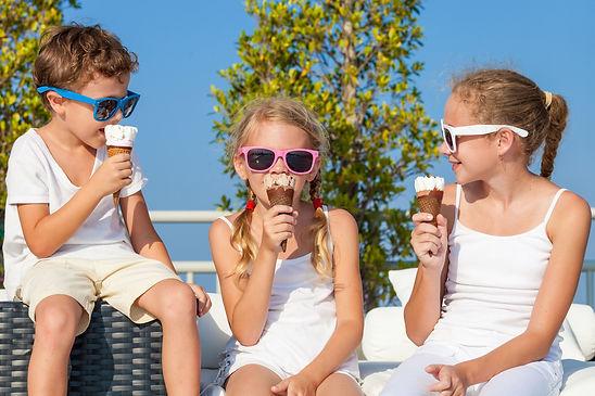 three-happy-children-eating-ice-cream-ne