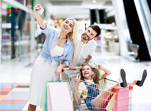 family-taking-shopping-selfie-on-smartph