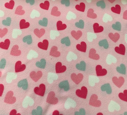Multi coloured hearts on pink fleece