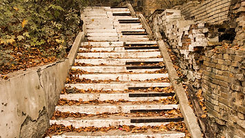Abandoned stairs, are painted in the style of piano keys surrounded by autumn fallen yello