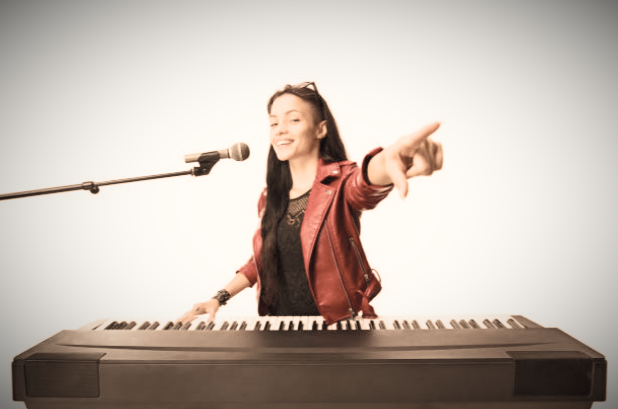 Girl singing and playing piano