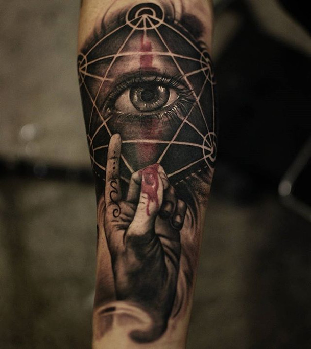Tattoo of seeing eye inside of triangle