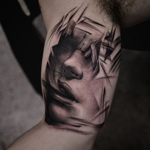 creative tattoo of man reflecting on tramatic life experience