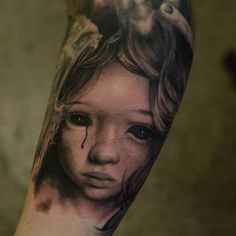 Demonic Doll Tattoo sad little girl