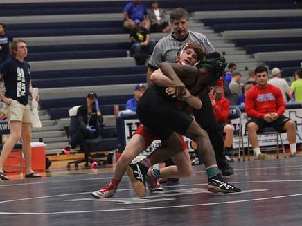 Pinning them down Freshman John Geiger excels in wrestling