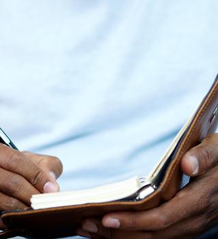 Man Writing in Journal (Script).png