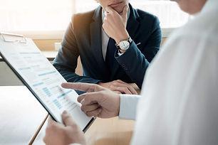 Business-Man-Interviewer-Looking-Skeptic
