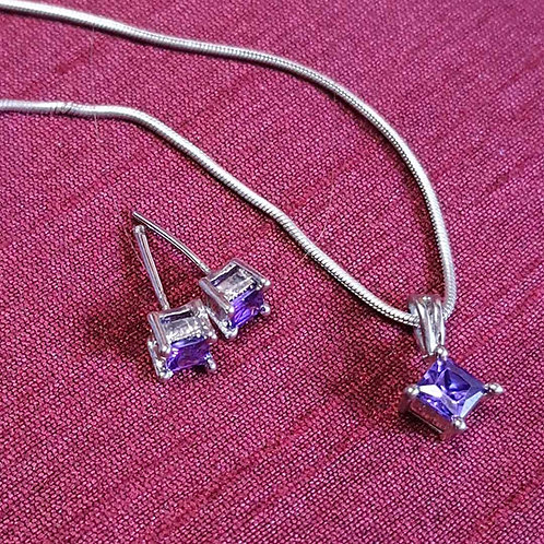 Purple diamond pendant set
