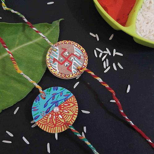 Handpainted traditional design rakhi set