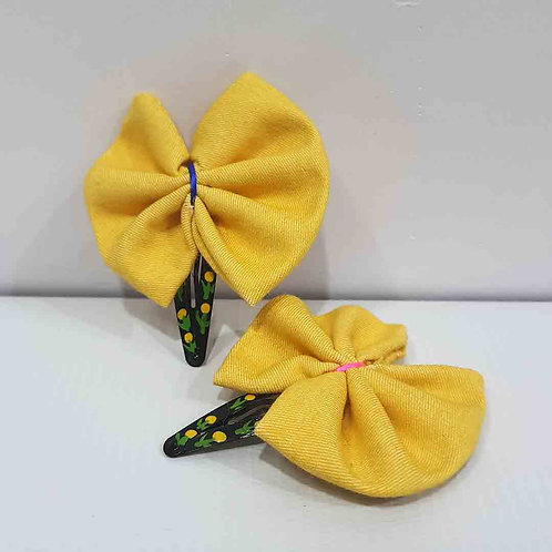 Bright yellow bow hairclips