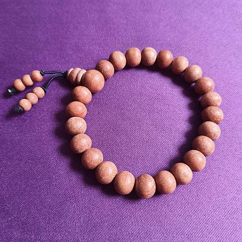 Yellow smooth sandalwood bead Wristlet