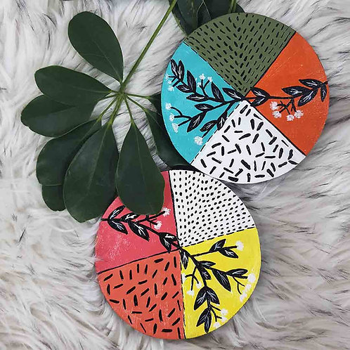 Polychromatic floral coaster set