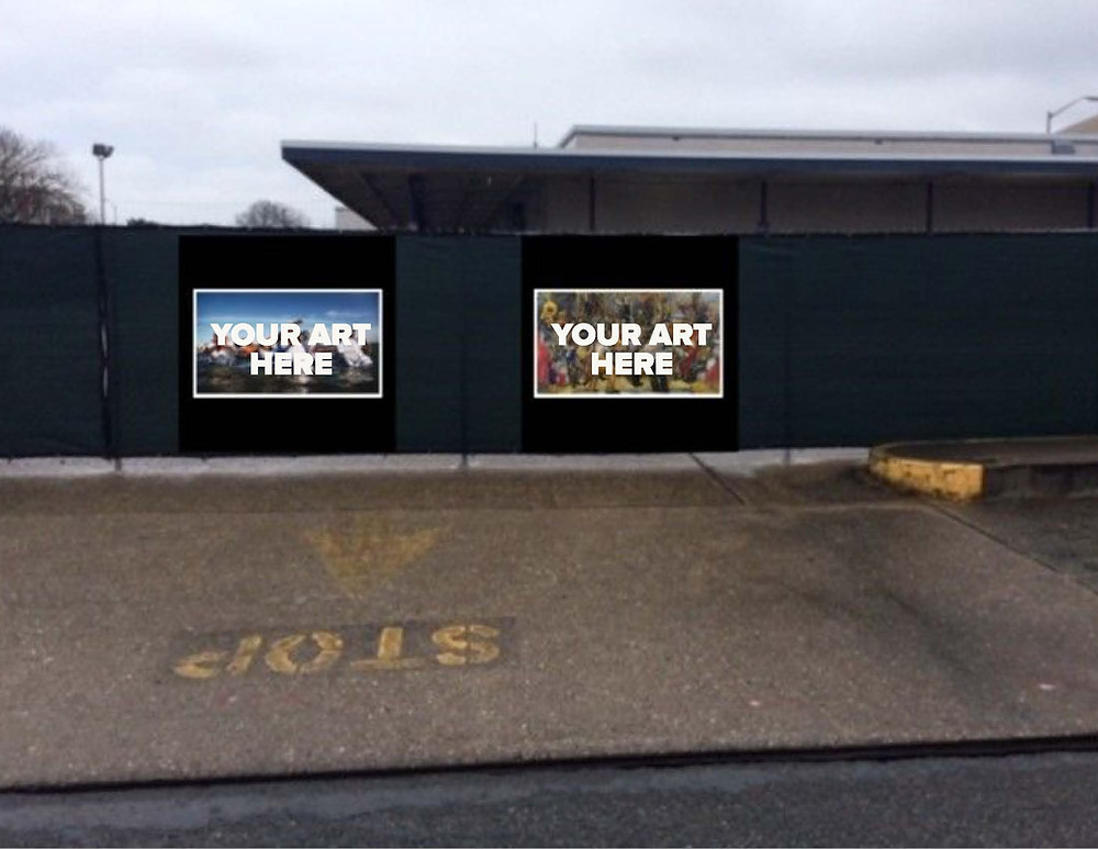 """The fence around the old Greyhound Bus station with frames on it reading """"Your Art Here"""""""