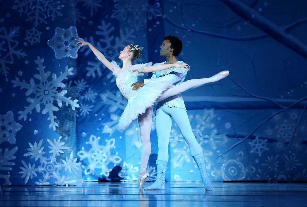 Ira White and Melissa Frain dance, they are surrounded by snowflakes.