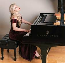Natasha Paremski sits playing her piano, wearing a stunning deep red dress