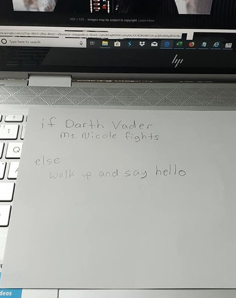"Card with this written on it: ""if Darth Vader, Ms. Nicole fights. Else, walk up and say hello"""
