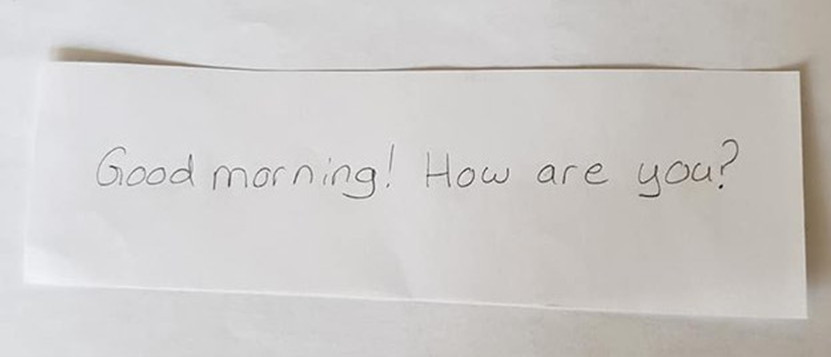"An index card that reads, ""Good morning! How are you?"""