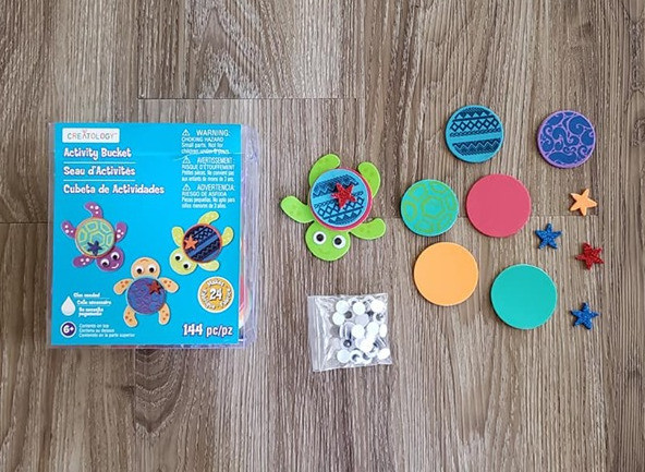 A foam craft kit for making turtles. It shows a completed turtle with a shell, a star, and eyes. It also shows the individual pieces separately.