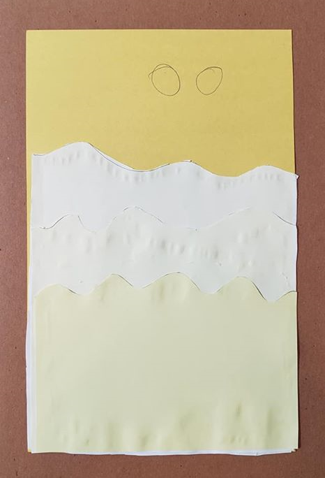 A photo of a child's artwork of the sand dunes on Tatooine, as described above.