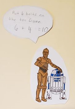 A drawing of C3P0 along with the math equation 6 + 4 = 10..