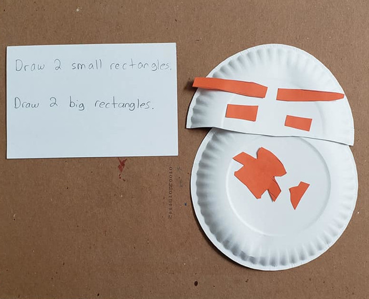 "A craft of a droid next to a card that reads, ""Draw 2 small rectangles. Draw 2 big rectangles."""