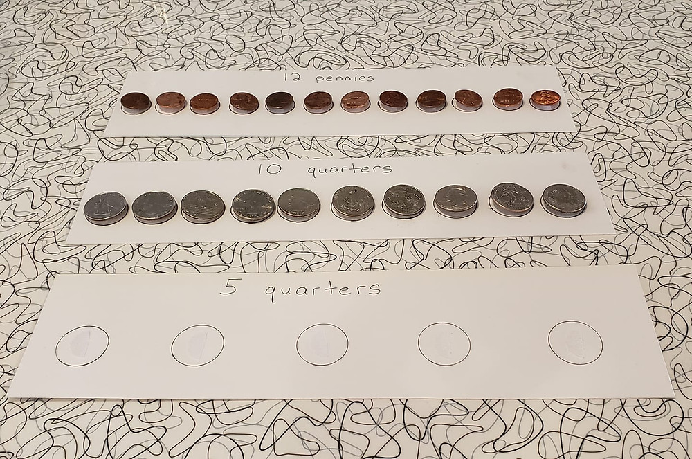 Three token boards with pennies or quarters as tokens.