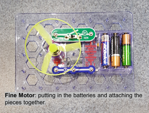 Fine Motor: putting in the batteries and attaching the pieces together.