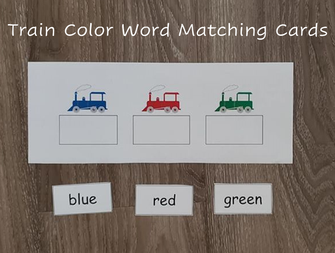 A photo of one of the train color word matching cards. It has a blue train, a red train, and a green train. There is an empty box below each train, where students can place the small cards that say the name of the color.