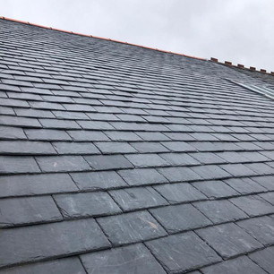 New slate roof replacement services near me