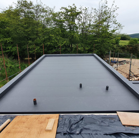 Commercial flat roofing specialists near me