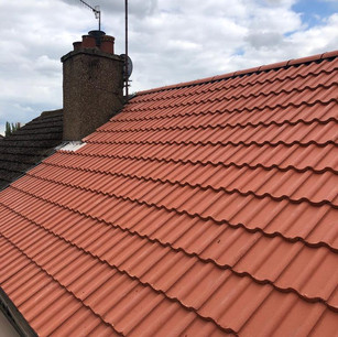 New red tile roof from roofing companies in Glasgow