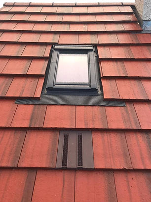 Marley modern red tile roof in Glasgow with velux window