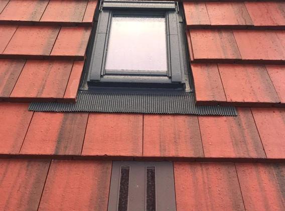 Marley-modern-old-English-dark-red-tiles-with-new-velux-window.jpg