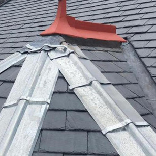 Slate roof turret with zinc hips