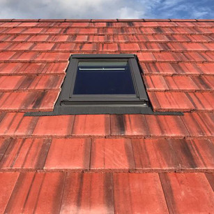 roofing company near me in Glasgow red tiled roof and velux windows