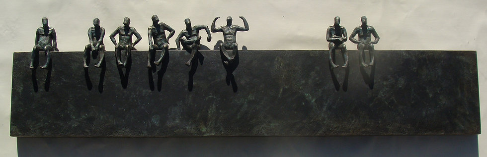 Small Beings sitting on bronze