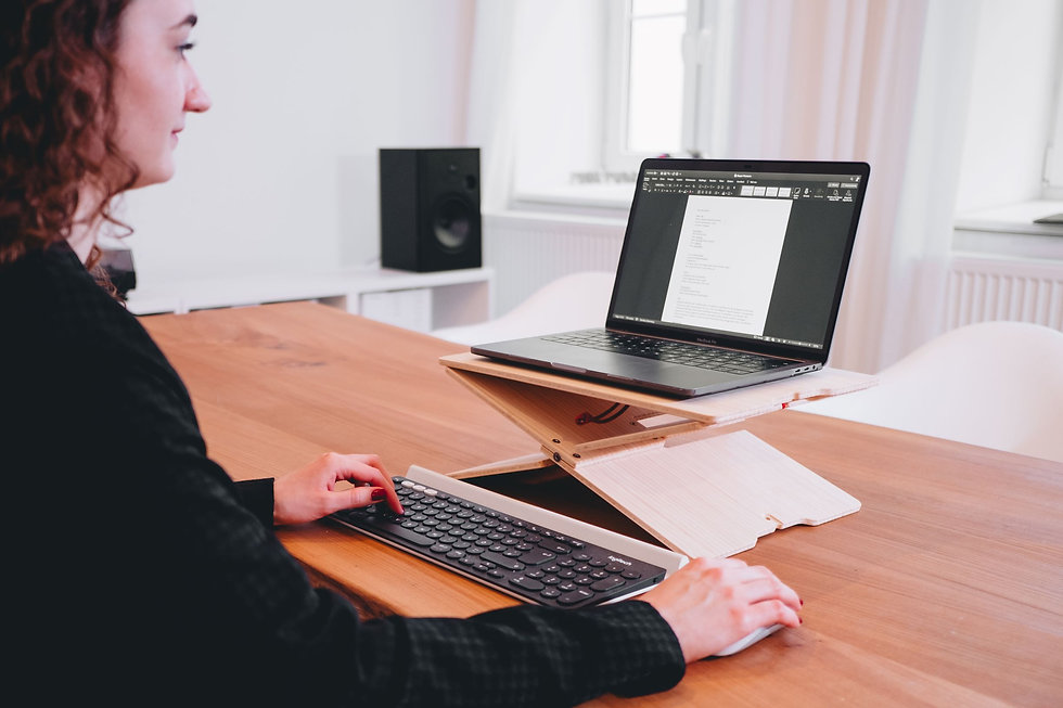 A person using hydesk while sitting