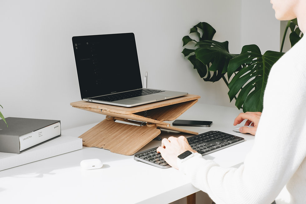 hydesk is propping up a laptop to a comfortable viewing height, a person is seen working with external keyboard and mouse.