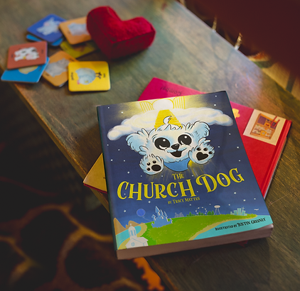 book on table with toys church dog.png