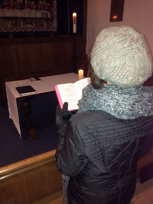 Lady in church on a cold day.