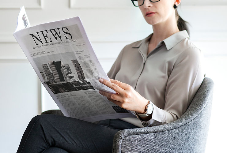 woman reading news.jpg