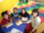 Kidspace - Niamh teaching reading.jpeg