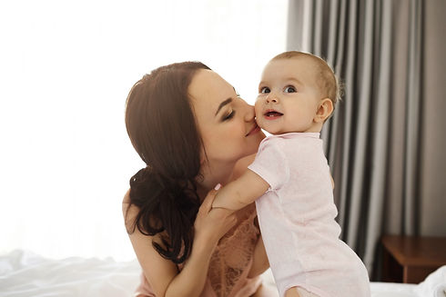 portrait-of-young-happy-tender-mom-and-h