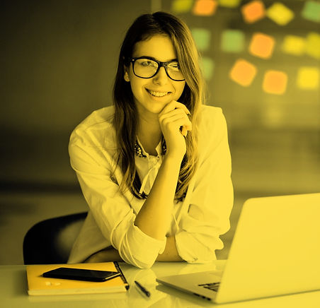 successful-businesswoman-working-on-laptop-computer-and-thinks-on-new-ideas-in-her-office-
