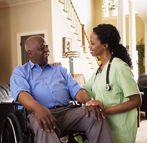 Nurse caring for a gentleman in a wheelchair