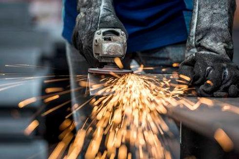 39640720-industrial-worker-cutting-metal