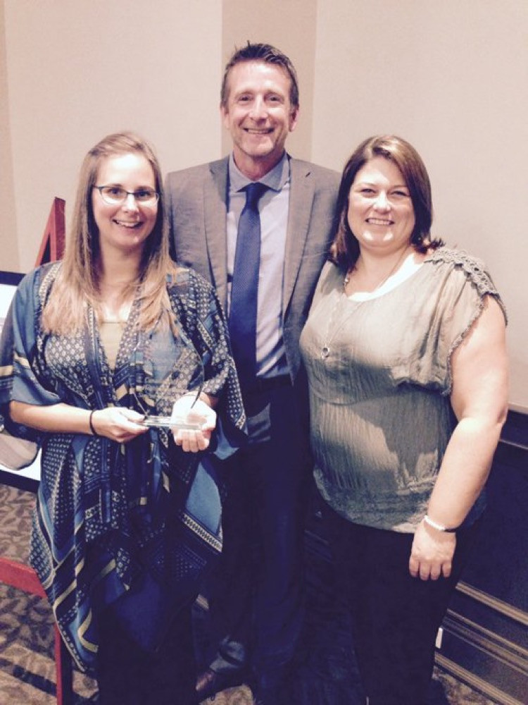 Receiving Community Award from Sara Peddle from David Busby